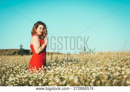 Woman With Red Dress And Poppy In Hand In The Field.