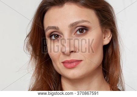 Close Up Portrait Of Young Attractive Woman With Eastern Type Of Beaty. Almond Shaped Brown Eyes, Wa