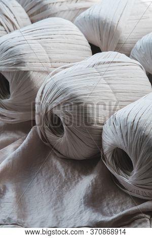 White Macrame Raffia Ropes In Skeins. Crocheting, Netting Handicraft Objects