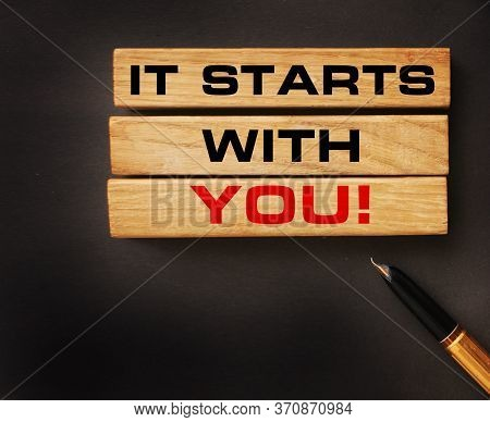 Text It Starts With You On Wooden Blocks And Vintage Luxury Pen. Concept Meaning Motivation For Star