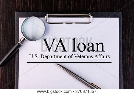 Notepad, Pen, Magnifying Glass Lie On A Table With The Text Va Loan. Business Concept.