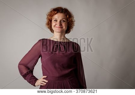 Red-haired Woman.
