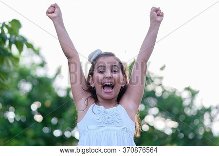 Victorious Girl, Screaming And Celebrating With Her Arms In The Air. Achievement, Success And Victor