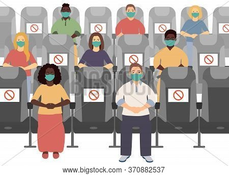 Social Distance In The Cinema. People Keep Distance, Sit Through One Chair Prohibition Signs, Safe.