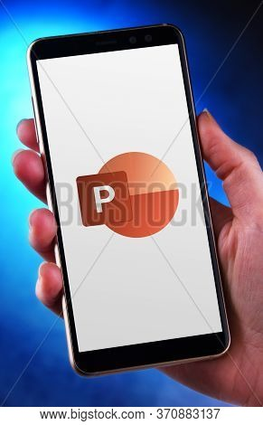 Poznan, Pol - May 21, 2020: Hand Holding Smartphone Displaying Logo Of Microsoft Powerpoint, A Prese