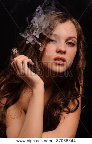 Portrait of pretty young smoking woman