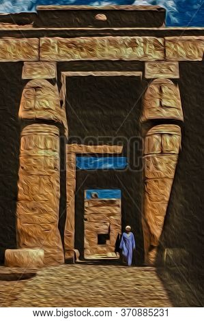 Egyptian Man Standing On Ruins From An Old Temple Covered By Hieroglyphics In The Karnak Temple Near