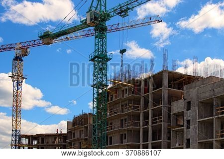 The Process Of Installation Tower Crane. Installation Work. Tower Crane Is Fixing With The Metal Ele