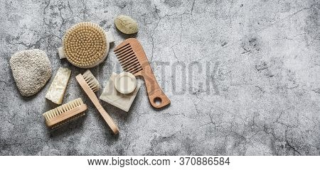 Body Care Health Banner. Natural Brushes, Soap, Pumice On A Gray Background, Top View. Copy Space