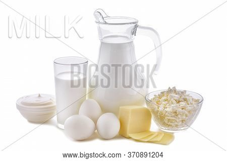 Dairy Products On White Background. Milk, Cottage Cheese, Sour Cream, Cheese, Butter, Eggs, Still Li