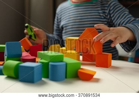 Creative Boy, Game In His Room. Little Boy Playing With Toys At The Table. Educational Games For Pre