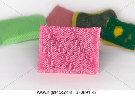 New Sponge For Washing Dishes The Sponge Is Pink And Has A Mesh Covering The Sponge. And Has An Old