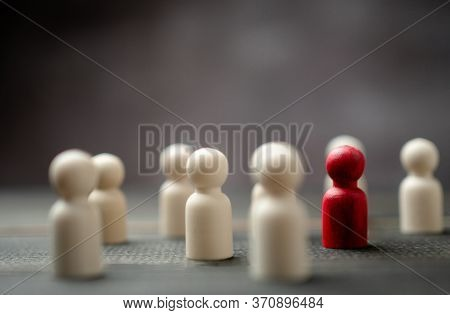 Wooden Figure Standing With Team To Show Influence And Empowerment. Concept Of Business Leadership F