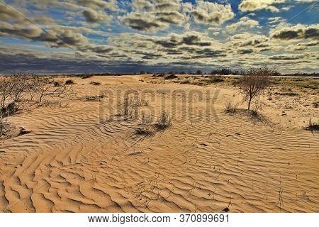 Karakum Desert At Sunset. Road Crossing The Karakum Desert In Turkmenistan.