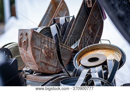 Old Rusty Metal Boxes And 35 Mm Film. Cinematographic Equipment.