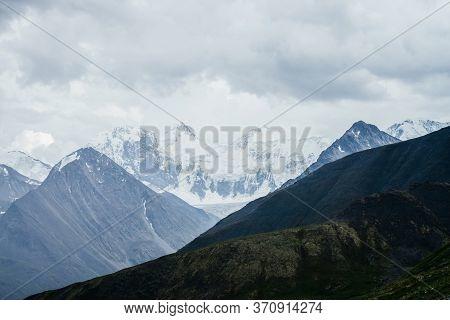 Wonderful View To Huge Glaciers On Great Snowy Mountain Range Behind Big Rocks Under Gloomy Cloudy S