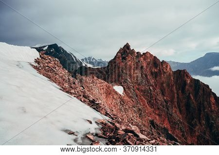 Surreal Pointed Rocky Pinnacle On Giant Snowy Mountain. Vivid Big Pointy Rocky Peak. Atmospheric Min