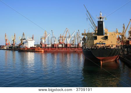 Dry-Cargo Ships At Port Moorings