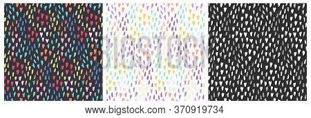 Set Of Cute Seamless Patterns With Mess Of Colorful Hearts And Dotted Elements. Lovely Simple Vector