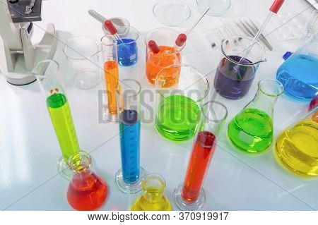 Scientist Working On Colorful Test Tube To Analysis And Develop Vaccine Of Covid-19 Virus In Lab Or