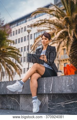 Entrepreneurial Session, A Young Caucasian Businesswoman On Break From Work Wearing A Black Blazer,