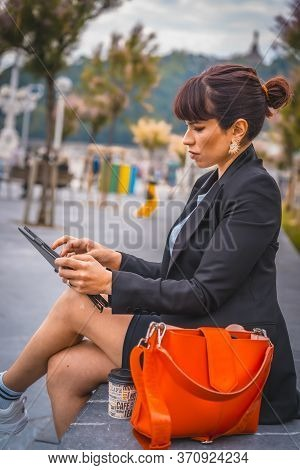 Entrepreneurial Session, A Young Businesswoman On Break From Work. Preparing For The Next Meeting