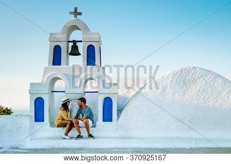 Couple On A Luxury Vacation In Greece, Oia Santorini Men And Woman At Caldera Infinity Pool Looking