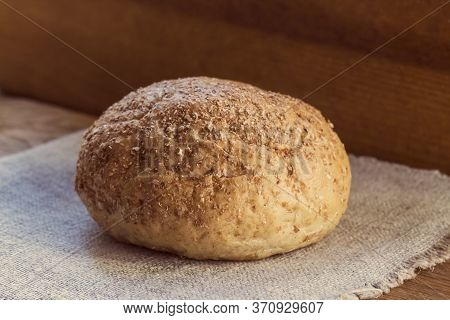 Loaf Of Bread With Bran Is On The Sackcloth, The Concept Of Healthy Food,