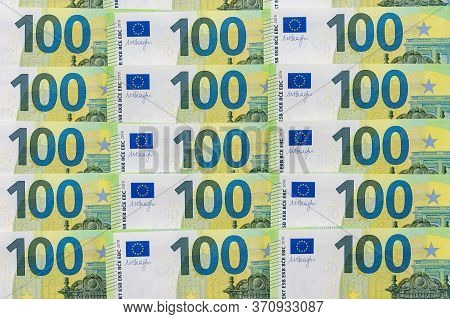 Banknotes Of 100 Hundred Euros Lie Exactly In Three Rows. European Currenc, Close-up. Blank For Desi