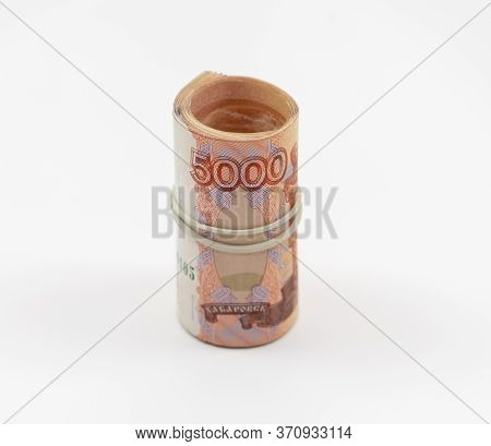 Banknotes Five Thousand Rubles 5000 In A Roll With An Elastic Band. Russian Curren To Save. Close-up