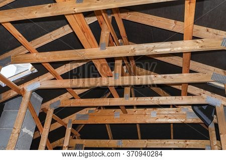 Attic With Visible Trusses, Roof Hatch For A Chimney Sweep And With A System Chimney.