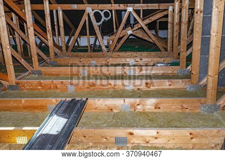 Ceiling And Attic Floor Insulation Made Of Rock Wool Between The Trusses, Visible System Chimney.