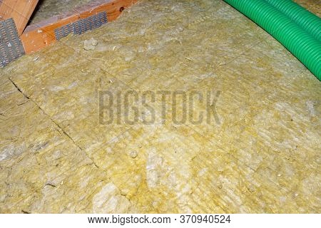 Ceiling And Attic Floor Insulation Made Of Rock Wool Between The Trusses.