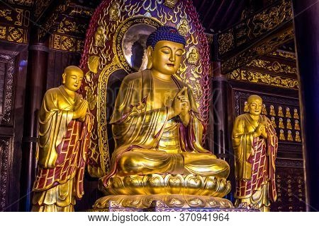 Xian, Shaanxi Province / China - August 4, 2015: Golden Buddha Statue At Giant Wild Goose Pagoda In