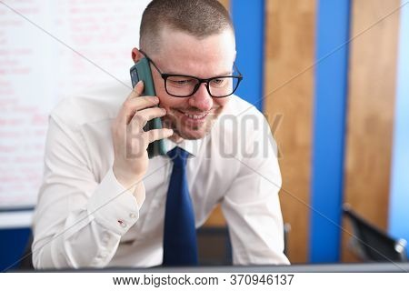 Portrait Of Smiling Person Talking On Mobile Phone And Decide Important Question. Happy Cheerful Adu