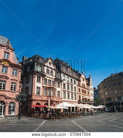 Mainz, Germany - August 12, 2018: Tourist People Enjoying Views Of Market Square Mainz Old Town, Dri