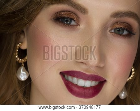Close-up Of The Beauty Of Half A Woman's Face With Creative Fashionable Make-up Of Sparkles. Black E