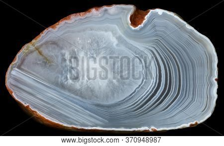 Slise Of Agate Geode With Quartz In The Center On Black. Russia, Kemerovo Region