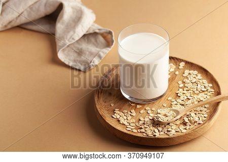 Vegan Oat Milk, Non Dairy Alternative Milk In A Glass. Vegan Non Dairy Alternative Milk. Oat Flakes