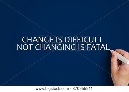 Concept Of Self-development, A Man Writes Change Is Difficult Not Changing Is Fatal