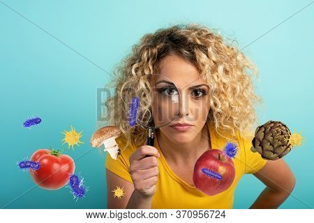 Girl Is Distrustful About Contagion Of Bacteria On Food. Cyan Background