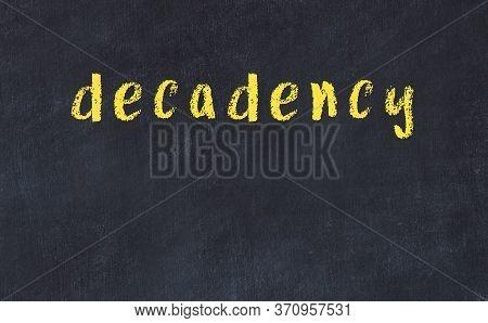 Chalk Handwritten Inscription Decadency On Black Desk