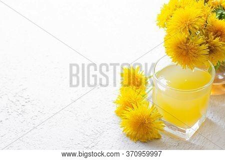 Dandelion Tea. Yellow Summer Flowers Dandelions. Tea Party Homemade Drink. Certified Flower Tea. An