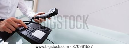 Telephone Landline Call. Person Using Corporate Office Phone