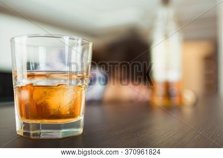 Young Woman In Kitchen During Quarantin. Glass With Whiskey Or Another Alcohol Drink In Front. Slepp