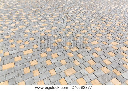 Paving Stone Tiles Of Square And Rectangular Shape Of Gray And Yellow Are Paved In Perspective, Clos