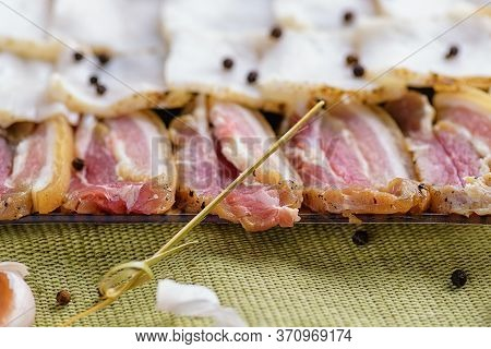 Raw Chopped Bacon For Cooking. Fresh Cold Sliced Bacon On The Background Of Natural Linen Fabric. Ra