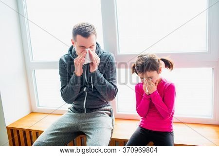 Young Father And His Cute Little Daughter Have Handkerchief And Runny Nose After Training On A Mat I