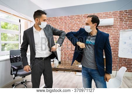 Man Avoiding Handshake To Stop Covid-19 Spread Doing Elbow Bump
