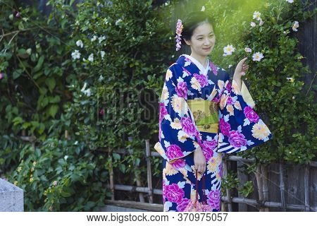 Kyoto, Japan - November, 8, 2019: Young Asian Girl Posing In Geisha Kimono In Traditional Japanese E